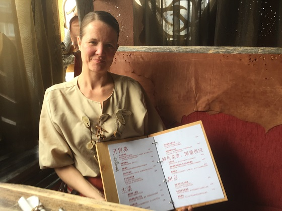 Katri Ruotsalainen, manager of Nili restaurant along with catalogue in Chinese language. DF Photo