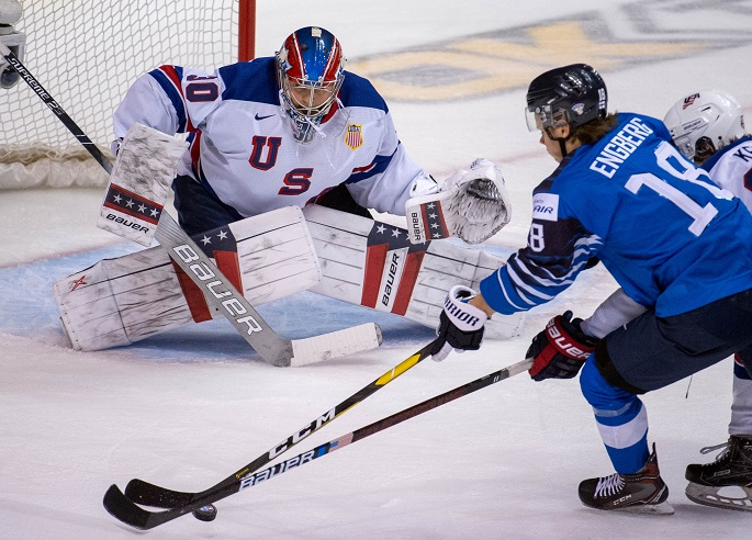 Team USA's goalie Cayden Primeau (L) prepares for a save during a match against Finland at the IIHF World Junior Championships in Vancouver, Canada, January, 5, 2019.Photo Xinhua by Andrew Soong.