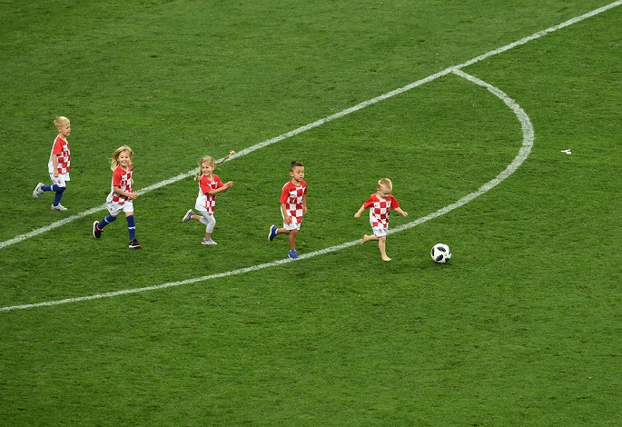 Children of Croatia's players enter into the pitch after the 2018 FIFA World Cup semi-final match between England and Croatia in Moscow, Russia, July 11, 2018. Photo Xinhua by Wang Yuguo.