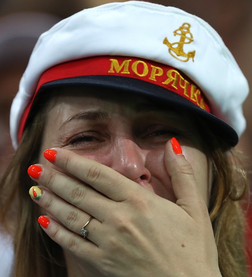 A fan of Russia reacts after the 2018 FIFA World Cup quarter-final match between Russia and Croatia in Sochi, Russia, July 7, 2018. Photo Xinhua by Xu Zijian.